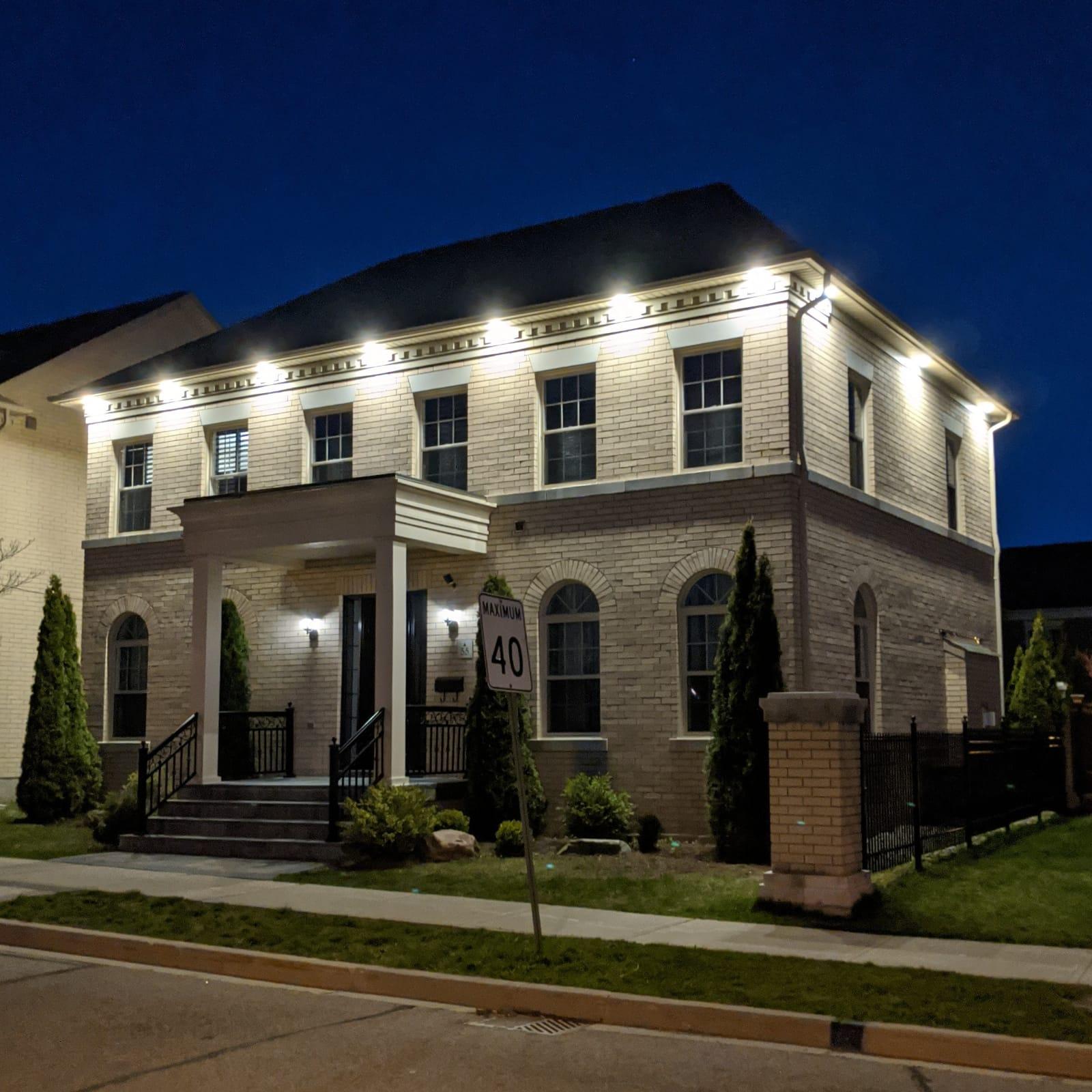 custom home with exterior potlights