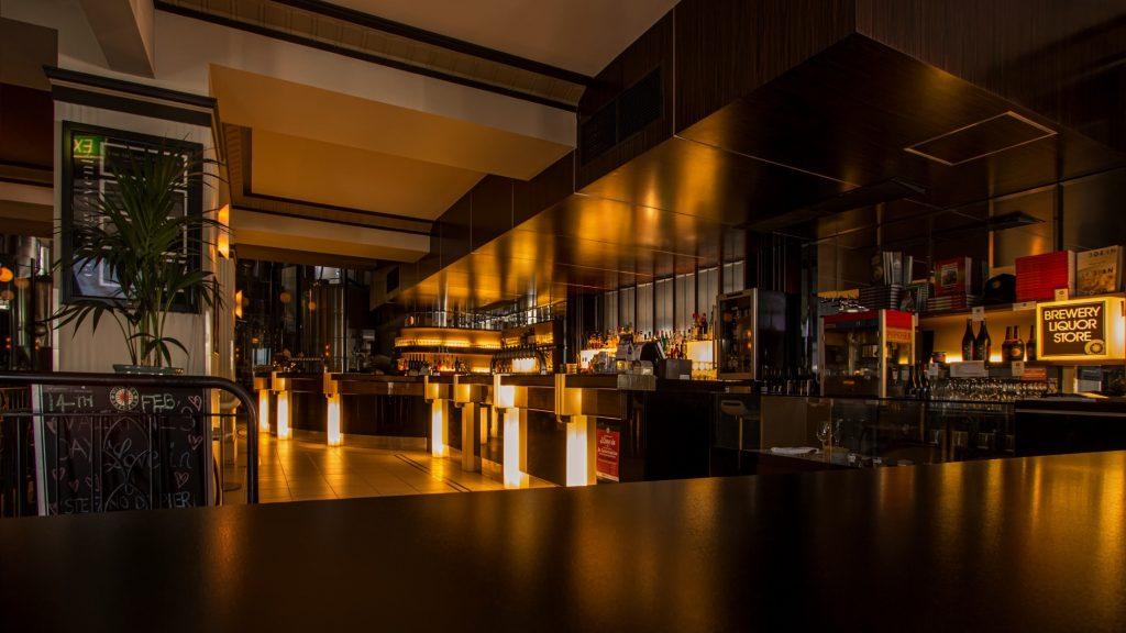 modern bar with back lit bar stand - pot light expert